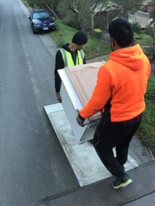 Two man unloading a furniture